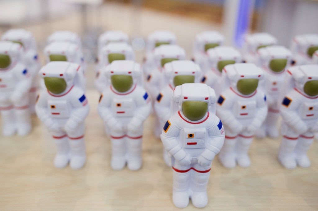 Toy astronauts stand at the Vencore Inc. booth during the 32nd Space Symposium in Colorado Springs. Matthew Staver/Bloomberg