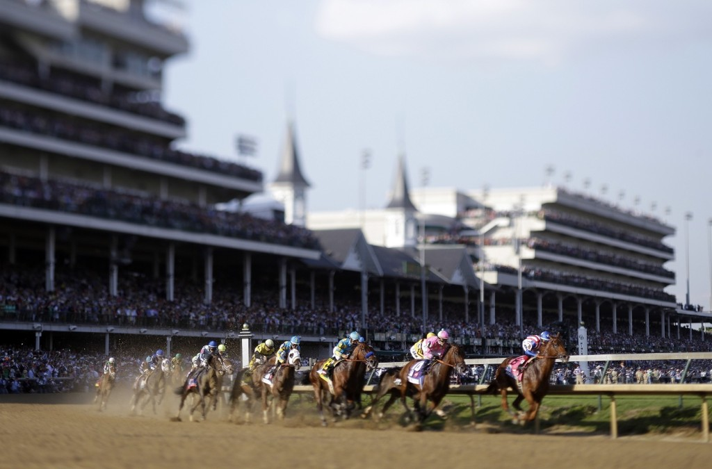 Horses make their way around turn one during the 141st running of the Kentucky Derby, at Churchill Downs, Saturday, in Louisville. AP Photo/Matt Slocum