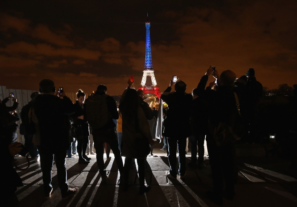 The Eiffel Tower is illuminated in Red, White and Blue in honor of the victims of Friday's terrorist attacks, Monday, in Paris, France. Christopher Furlong/Getty Images