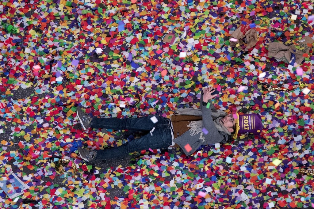 A reveler takes a selfie in the confetti in Times Square on New Year's Eve. AP Photo/Mary Altaffer