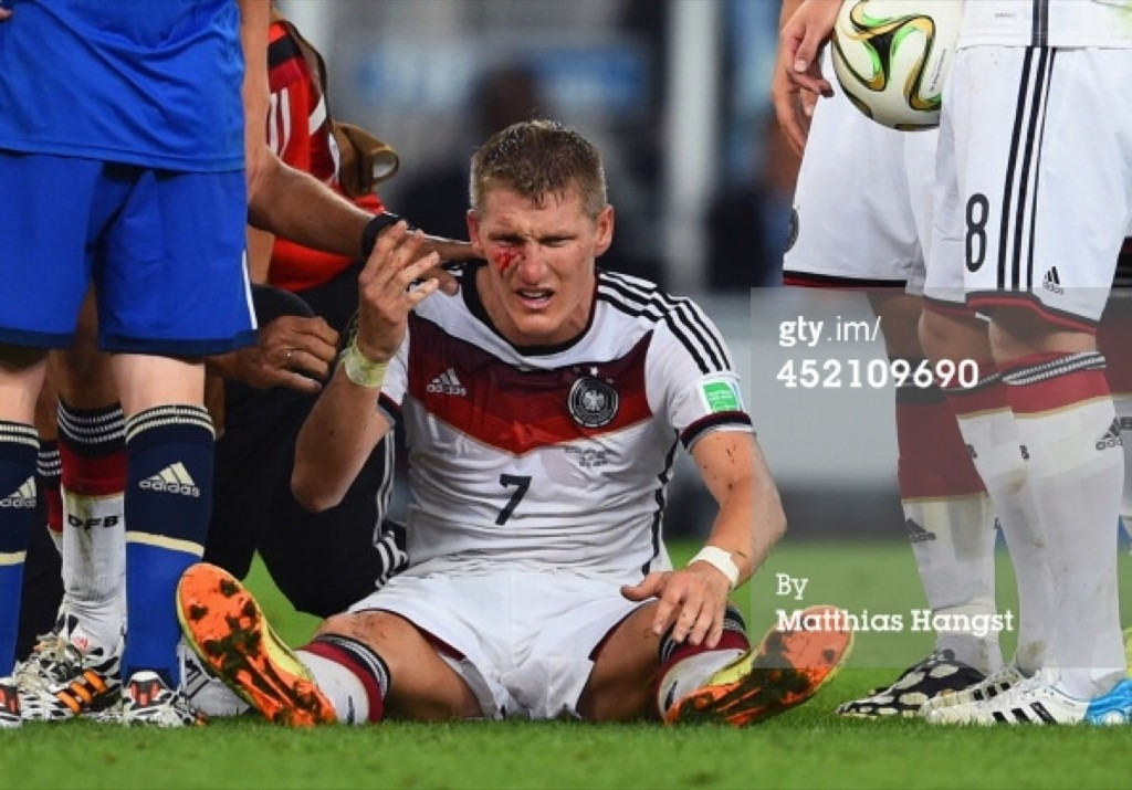 Bastian Schweinsteiger of Germany receives treatment after a collision. Matthias Hangst/Getty Images