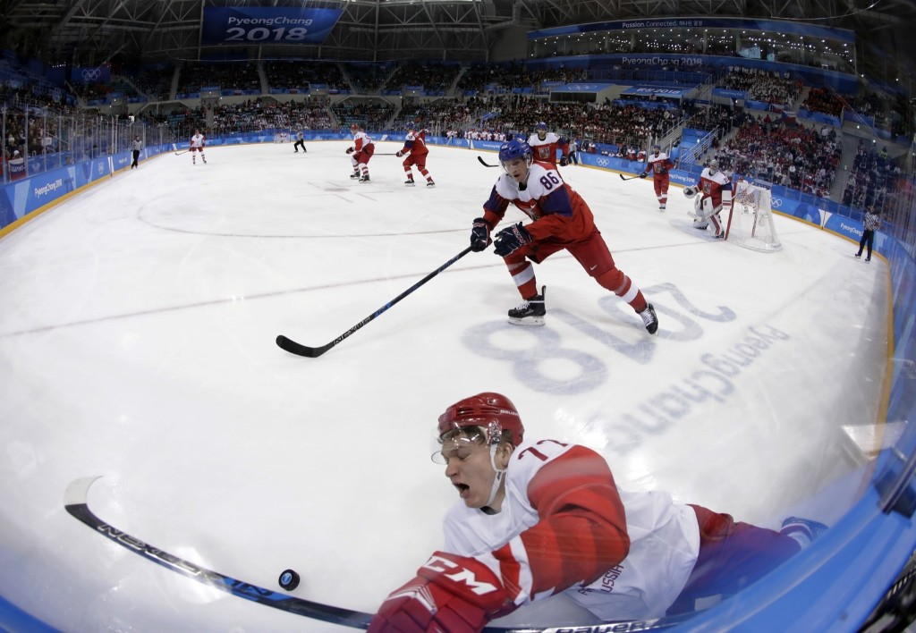 Russian athlete Kirill Kaprizov (77) crashes into the wall during the third period against the Czech Republic. AP Photo/Julio Cortez