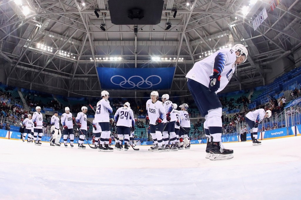 The U.S. team after being knocked out of the hockey tournament at the Olympics. Ronald Martinez/Getty Images