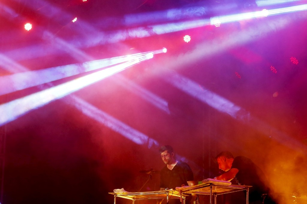 Electronic music group Odesza performs Sunday. REUTERS/Lucy Nicholson