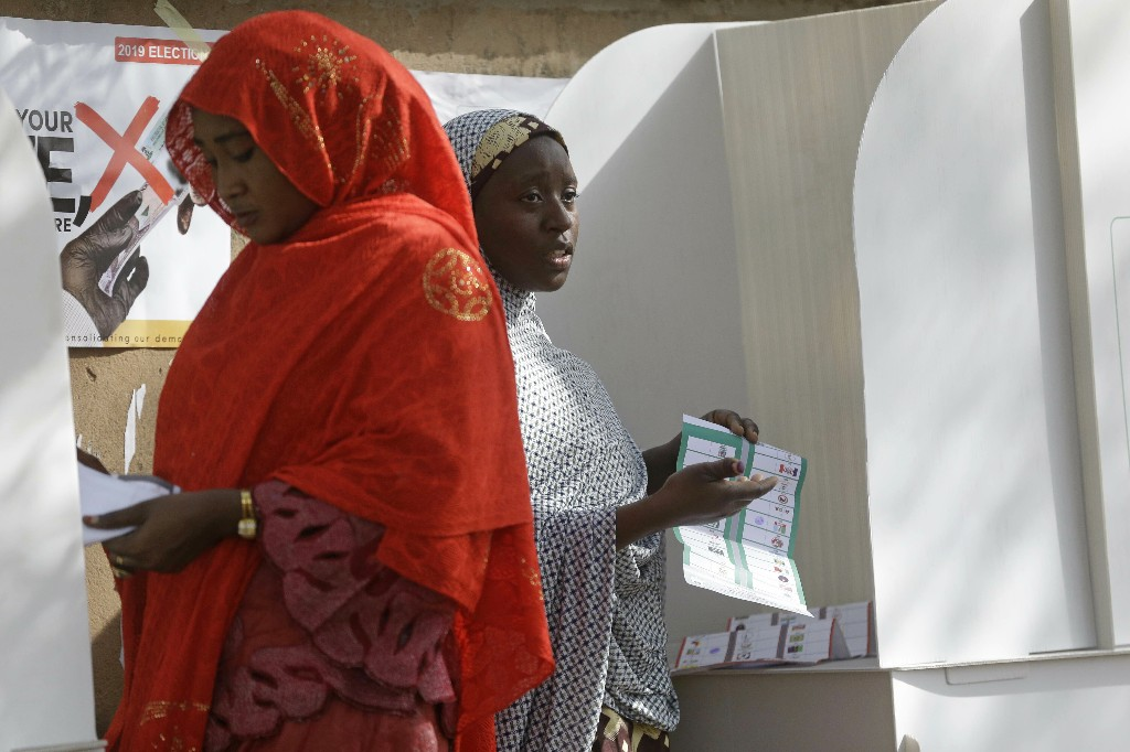 Women prepare to cast ballots during the Presidential and National Assembly election in Yola Nigeria, Saturday, Feb. 23, 2019. Incumbent President Muhammadu Buhari is to face opposition presidential candidate Atiku Abubakar in the presidential election. (AP Photo/Sunday Alamba)