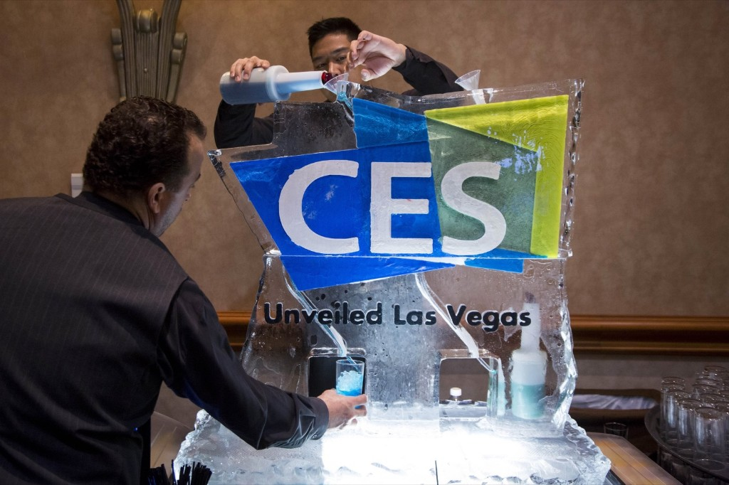 Workers pour a blue vodka-based drink through a CES-branded ice luge during press event ahead of the 2015 Consumer Electronics Show in Las Vegas. Michael Nagle/Bloomberg