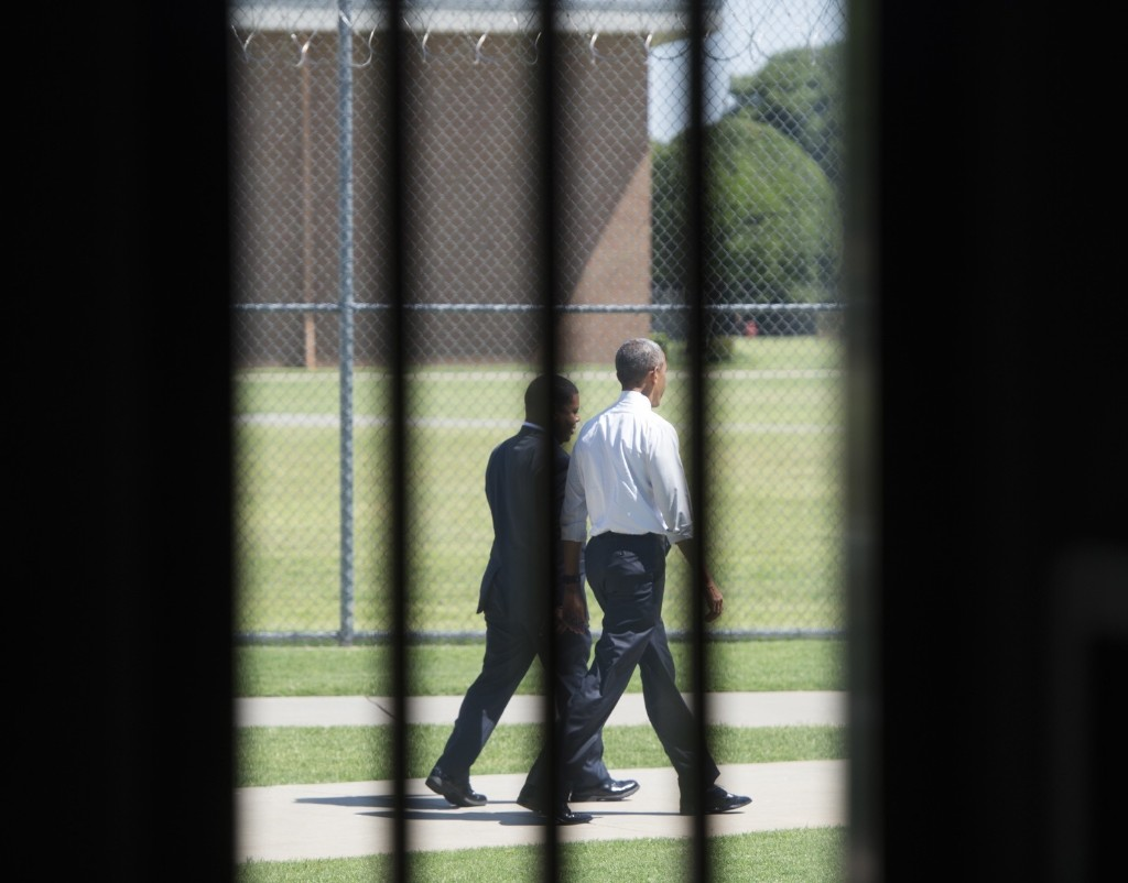 US President Barack Obama walks through the prison yard during a tour of the El Reno Federal Correctional Institution in El Reno, Oklahoma, Thursday. SAUL LOEB/AFP/Getty Images