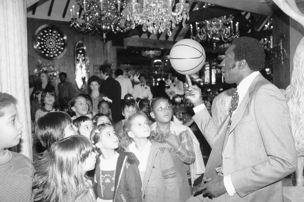 Meadowlark Lemon at a children's benefit toy auction at New York's Tavern on the Green, 1979. AP Photo/Dave Pickoff