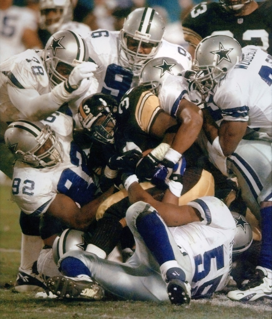 Pittsburgh Steelers Bam Morris is stopped short of a first down by Cowboy defenders during third quarter of Super Bowl XXX in Tempe, Ariz., Jan. 1996. Dallas won, 27-17. At this game the AP became the first news organization to shoot the Super Bowl using only digital cameras. AP Photo/Amy Sancetta