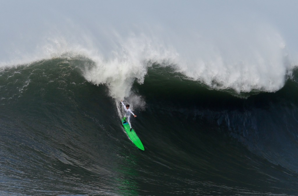 Nic Lamb rides a wave during round one. Ezra Shaw/Getty Images