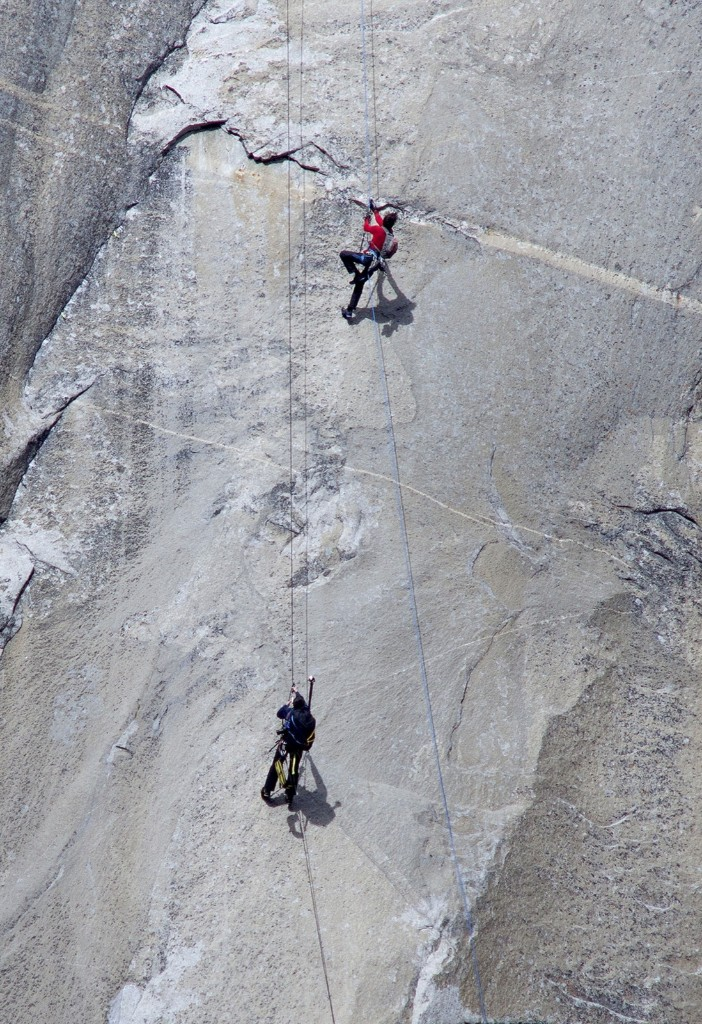 Kevin Jorgeson, top, and a photographer ascend ropes. AP Photo/Tom Evans/elcapreport
