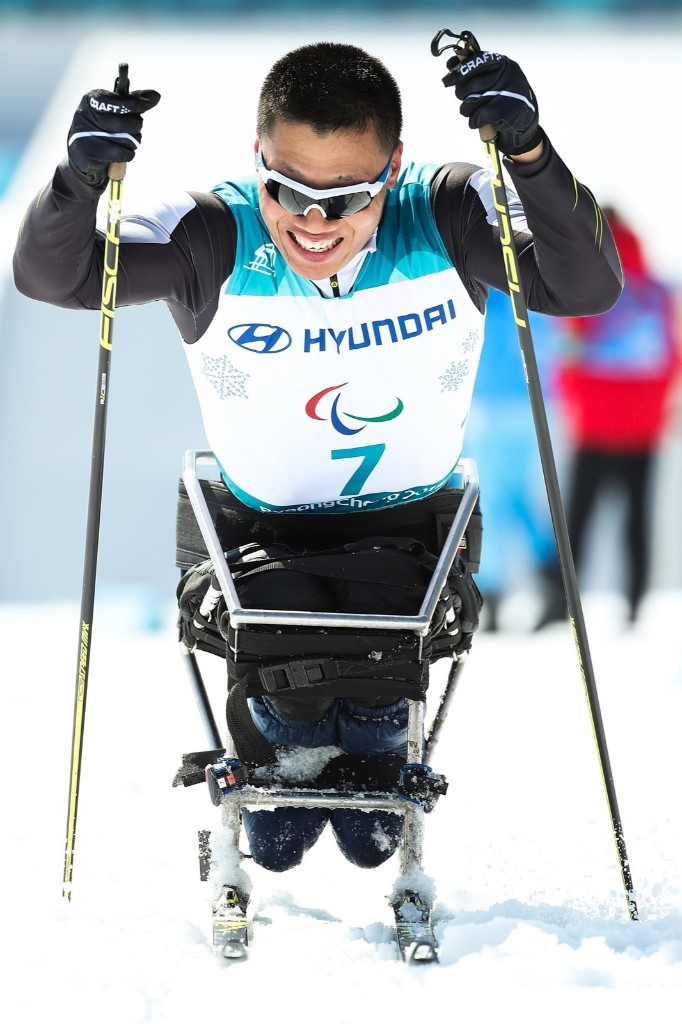 Xu Congjun of China competes in the men's Cross Country 15km Sitting event. Lintao Zhang/Getty Images