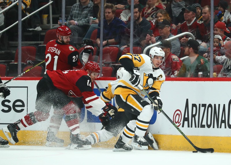 Jan 18, 2019; Glendale, AZ, USA; Pittsburgh Penguins center Sidney Crosby (87) against Arizona Coyotes right wing Richard Panik (14) in the first period at Gila River Arena. Mandatory Credit: Mark J. Rebilas-USA TODAY Sports