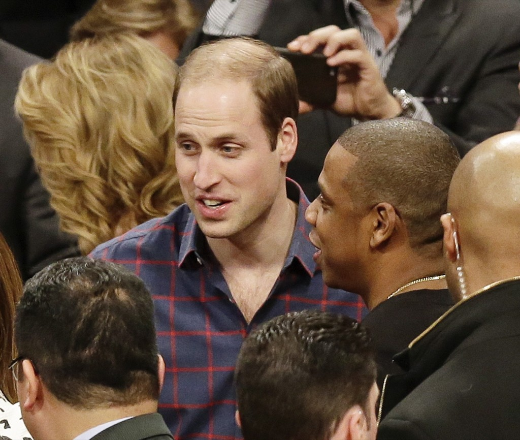 Prince William, Duke of Cambridge talks with Jay-Z at the NBA game between the Brooklyn Nets and the Cleveland Cavaliers, Monday in New York. AP Photo/Frank Franklin