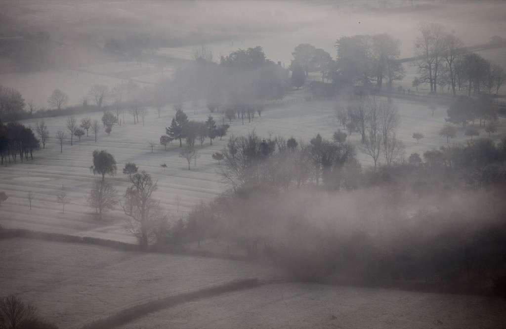 Mist and frost linger in fields surrounding Glastonbury Tor in Somerset, England. Matt Cardy/Getty Images