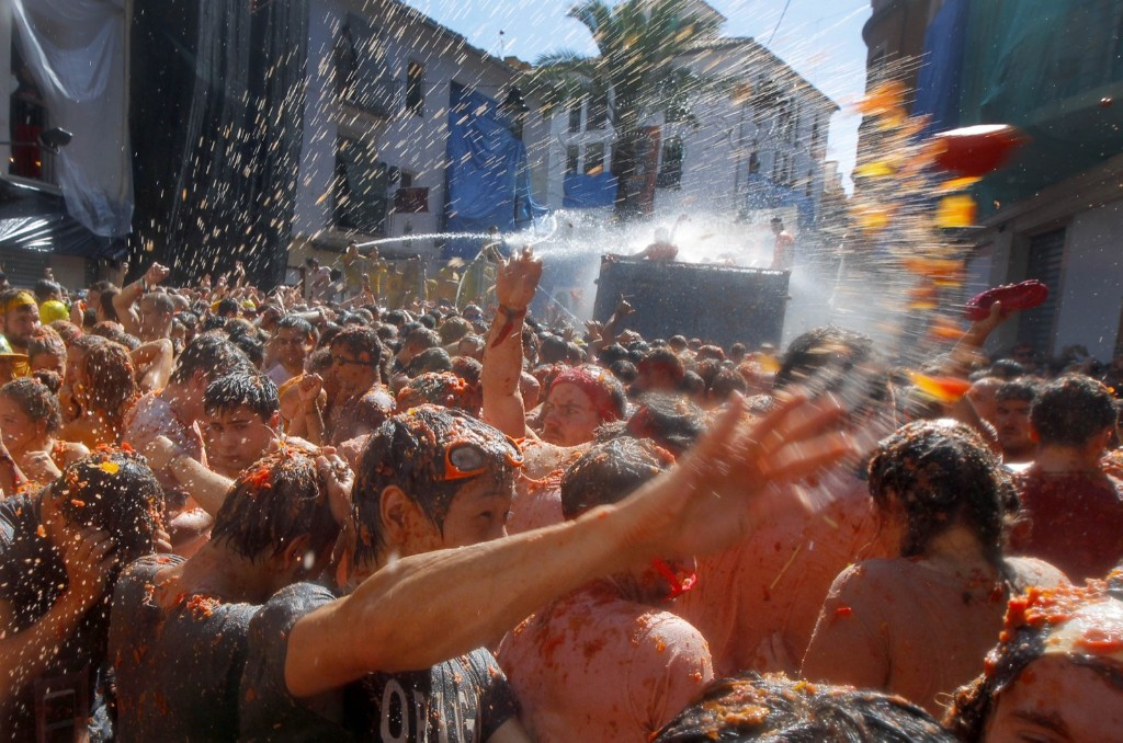 The hour-long street bash was inspired by a food fight among kids in 1945. AP Photo/Alberto Saiz