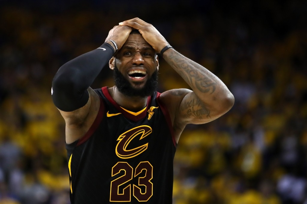 LeBron James of the Cleveland Cavaliers near the end of overtime loss to the Golden State Warriors in Game 1 of the NBA Finals. A disputed foul call and a teammate's gaffe at the end of regulation cost the Cavs a victory. Ezra Shaw/Getty Images)