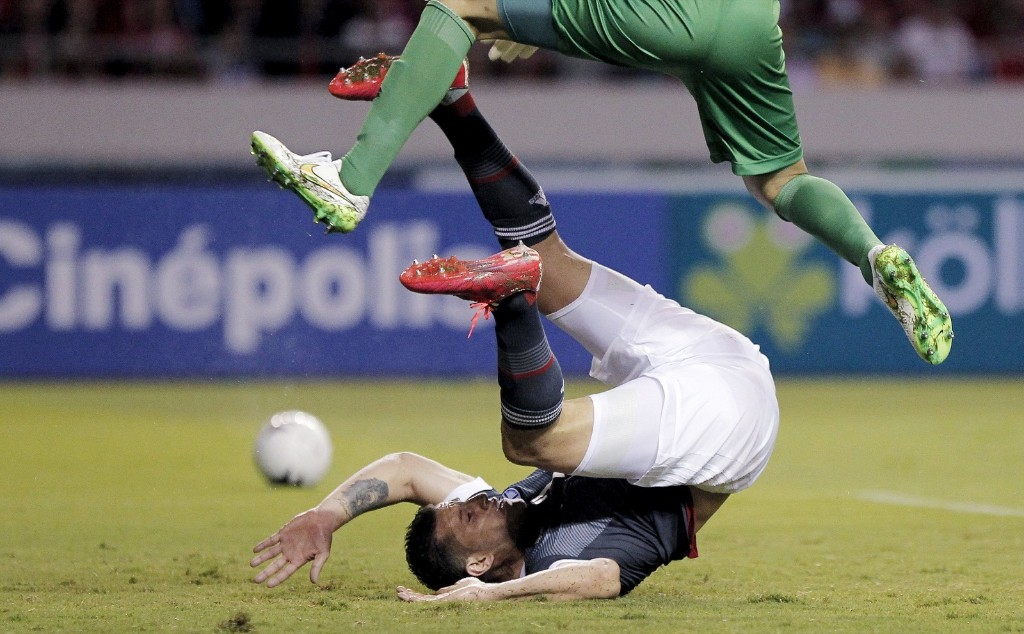 Goalkeeper Keylor Navas of Costa Rica jumps over Raul Bobadilla of Paraguay during their friendly soccer match in San Jose REUTERS/Juan Carlos Ulate