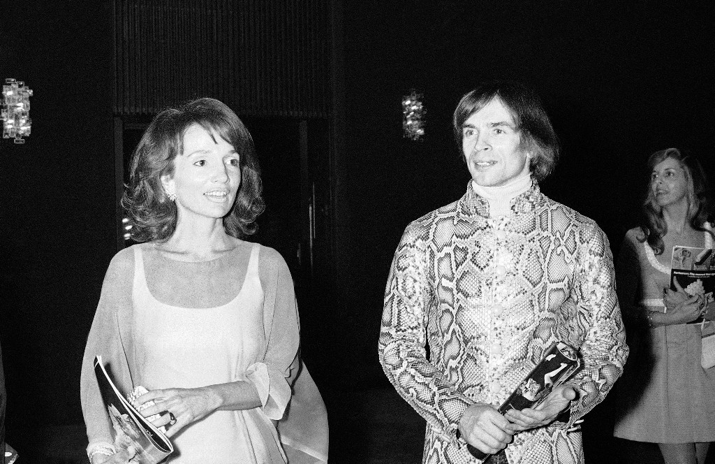 "FILE - In this May 8, 1974 file photo, dancer Rudolf Nureyev, right, and Princess Lee Radziwill talk together during intermission at a performance of ""Manon"" by the Royal Ballet at the Metropolitan Opera House at Lincoln Center in New York. Radziwill, the stylish jet setter and socialite who made friends worldwide even as she bonded and competed with her older sister Jacqueline Kennedy, has died. She was 85. Anna Christina Radziwill told The New York Times her mother died Friday, Feb. 15, 2019, of what she described as natural causes. (AP Photo, File)"