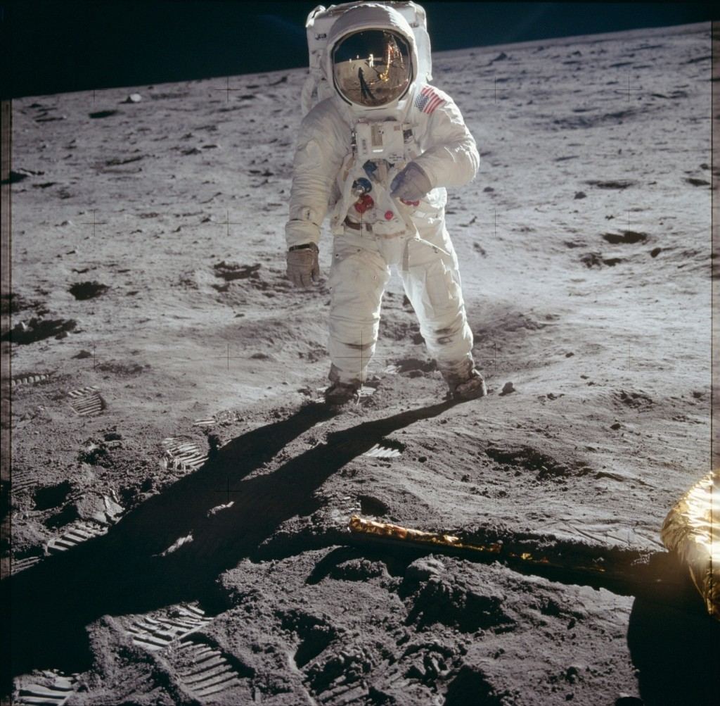 """Astronaut Buzz Aldrin, lunar module pilot, walks on the surface of the moon near the leg of the Lunar Module """"Eagle"""" during the Apollo 11 extravehicular activity. Astronaut Neil A. Armstrong, commander, took this photograph with a 70mm lunar surface camera. NASA Photo"""