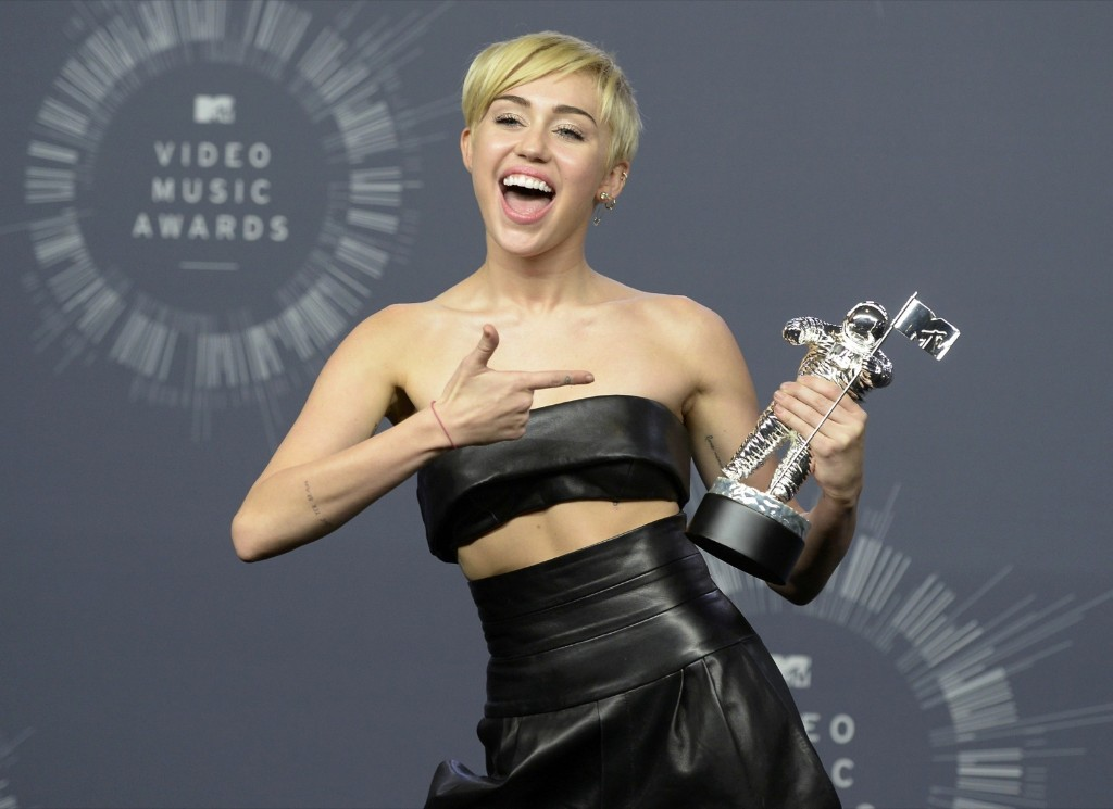 "Miley Cyrus after winning Video of the Year for ""Wrecking Ball"". REUTERS/Kevork Djansezian"