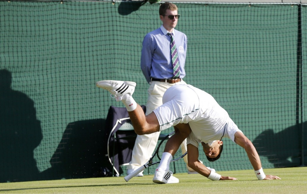 Novak Djokovic slips during his match against Kevin Anderson. REUTERS/Suzanne Plunkett