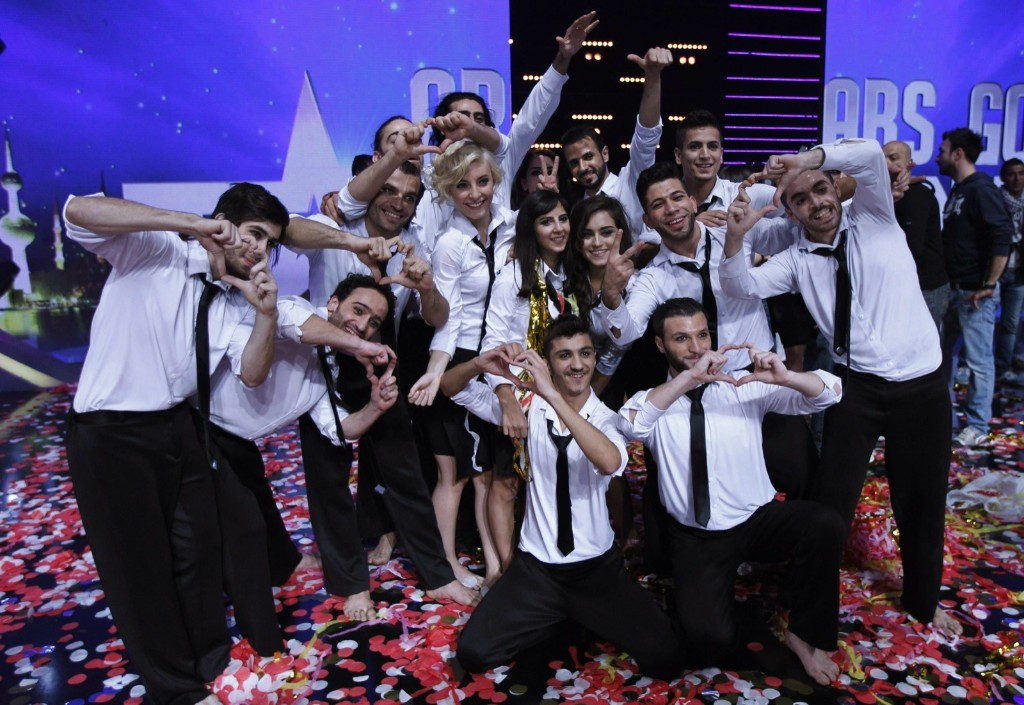 """Members of the Sima dance group of Syria pose for a photo after they were announced winner of the Season 3 finale of """"Arabs Got Talent"""" in Zouk Mosbeh area, north of Beirut Saturday. REUTERS/Mohammed Azakir"""