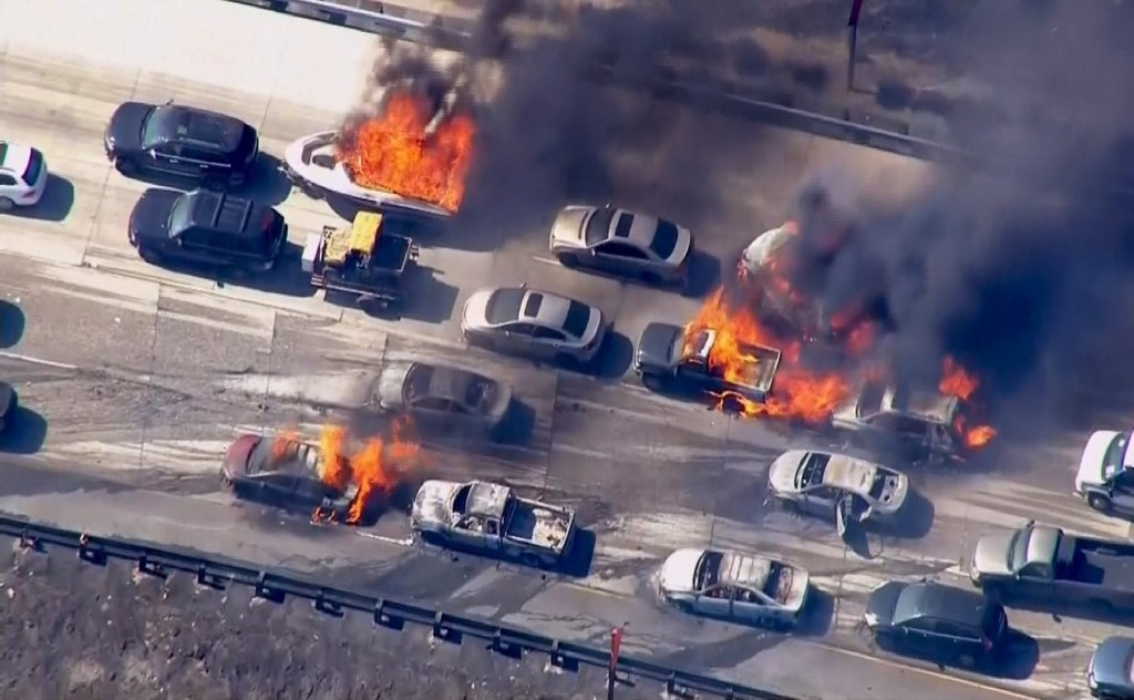 Cars burning on Interstate 15 in Cajon Pass, Calif. REUTERS/