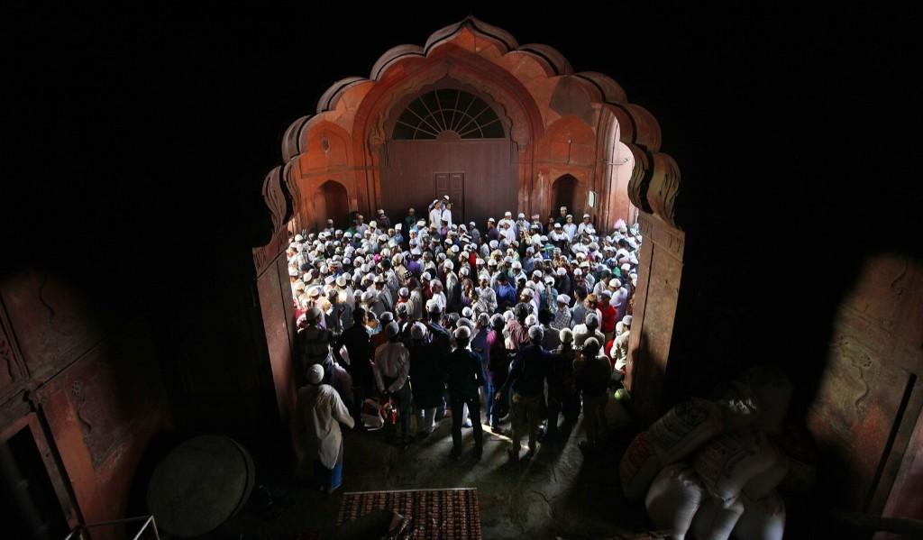 Indian Muslims offering prayer at Jama Masjid during Eid al-Adha in New Delhi. Raj K Raj/Hindustan Times/Getty Images