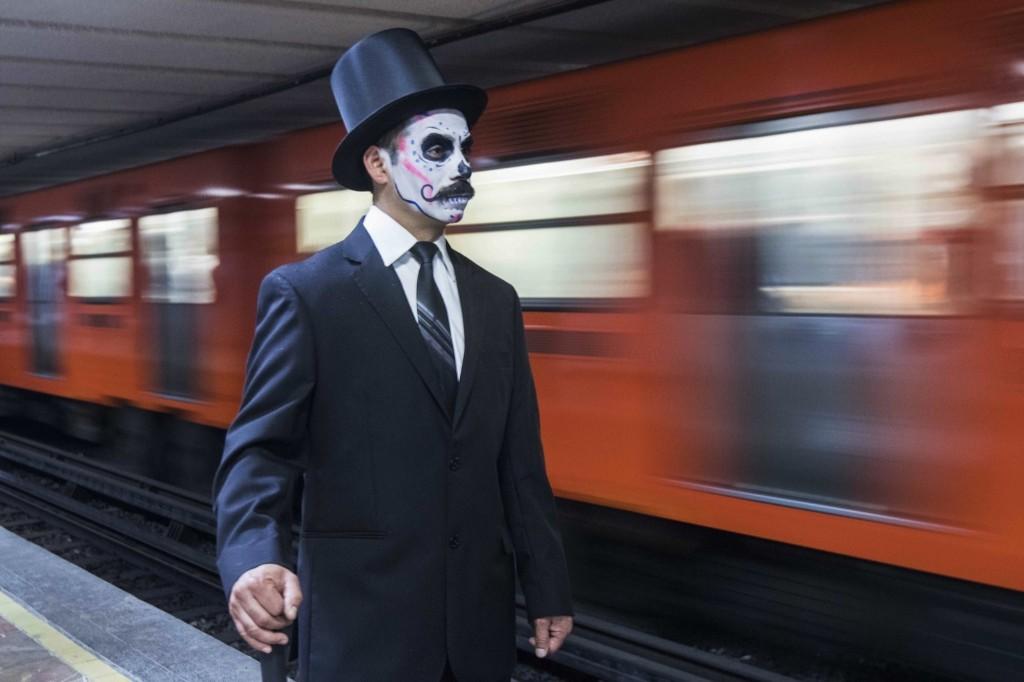 A man on his way to the annual Catrinas parade. AP Photo/Christian Palma