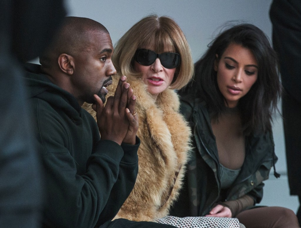 Kanye West watches models rehearse while sitting with his wife Kim Kardashian and Anna Wintour before presenting his Fall/Winter 2015 partnership with Adidas at New York Fashion Week, Thursday. REUTERS/Lucas Jackson