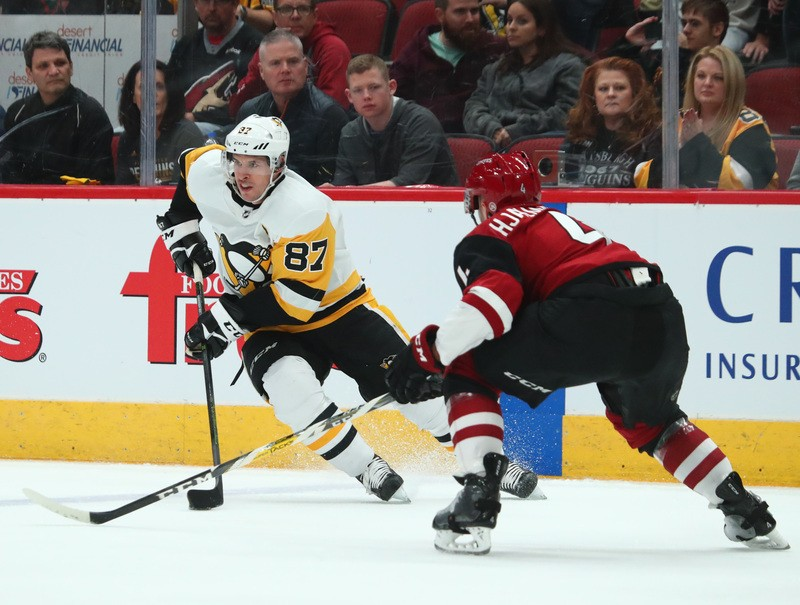 Jan 18, 2019; Glendale, AZ, USA; Pittsburgh Penguins center Sidney Crosby (87) controls the puck against the Arizona Coyotes in the first period at Gila River Arena. Mandatory Credit: Mark J. Rebilas-USA TODAY Sports