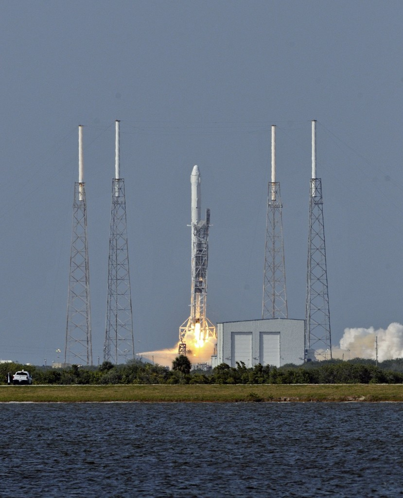 Space X's Falcon 9 rocket lifts off with an unmanned Dragon cargo craft from the launch platform in Cape Canaveral. After four failed bids SpaceX finally stuck the landing, powering the first stage of its Falcon 9 rocket onto an ocean platform where it touched down upright after launching cargo to space. BRUCE WEAVER/AFP/Getty Images