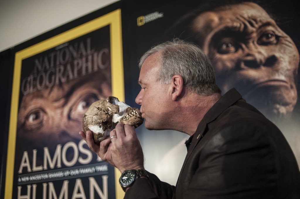Professor Lee Berger kisses the skull of aHomo Naledi , a newly discovered human ancestor during the unveiling of the discovery, Thursday, in Maropeng. STEFAN HEUNIS/AFP/Getty Images