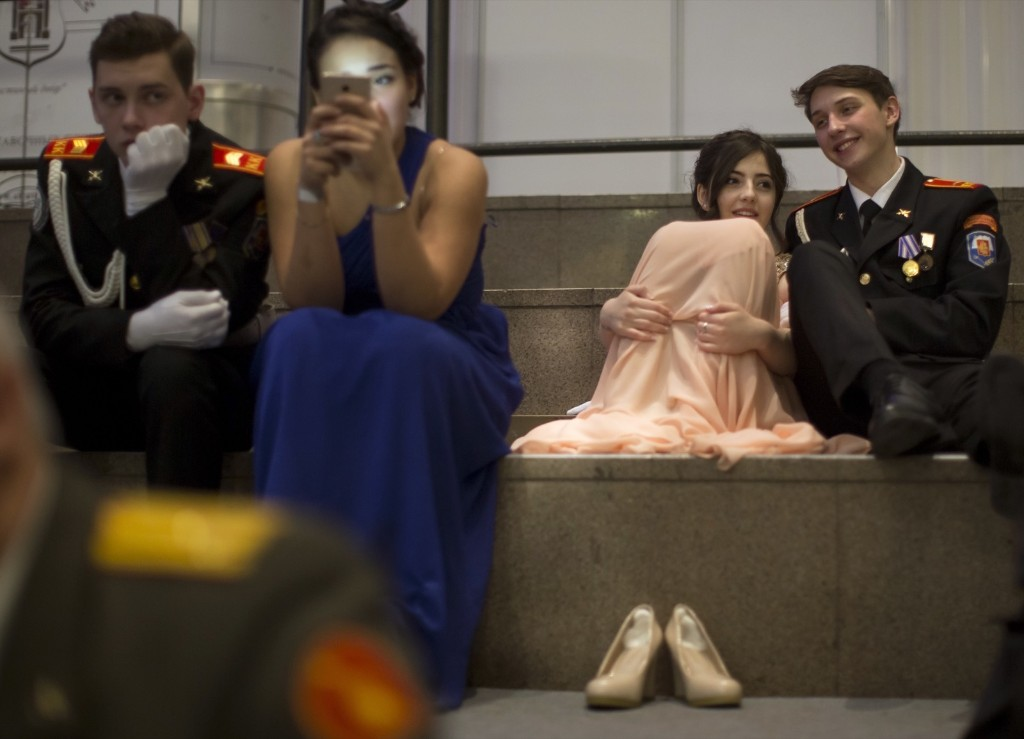 Students of military schools rest as they wait to perform during the annual ball in Moscow. AP Photo/Alexander Zemlianichenko