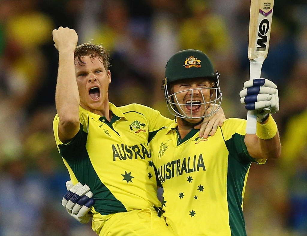 Steve Smith and Shane Watson of Australia celebrate victory in the 2015 ICC Cricket World Cup final match against New Zealand, Sunday, in Melbourne. Ryan Pierse/Getty Images