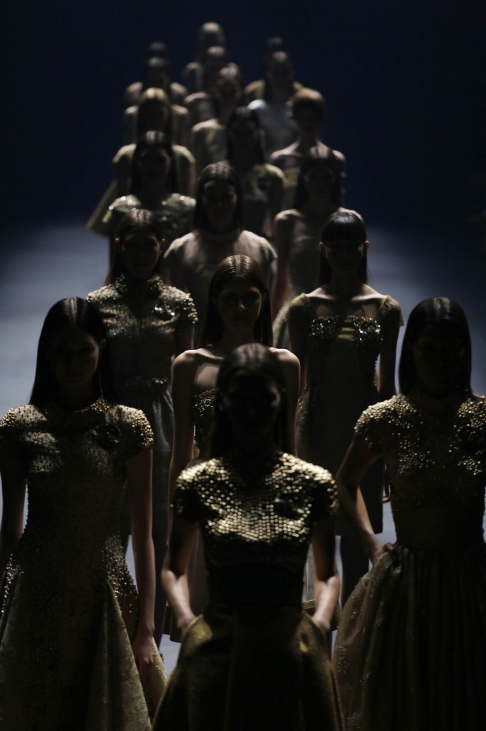 Models wear creations from the Acquastudio Winter collection during Sao Paulo Fashion Week. AP Photo/Nelson Antoine