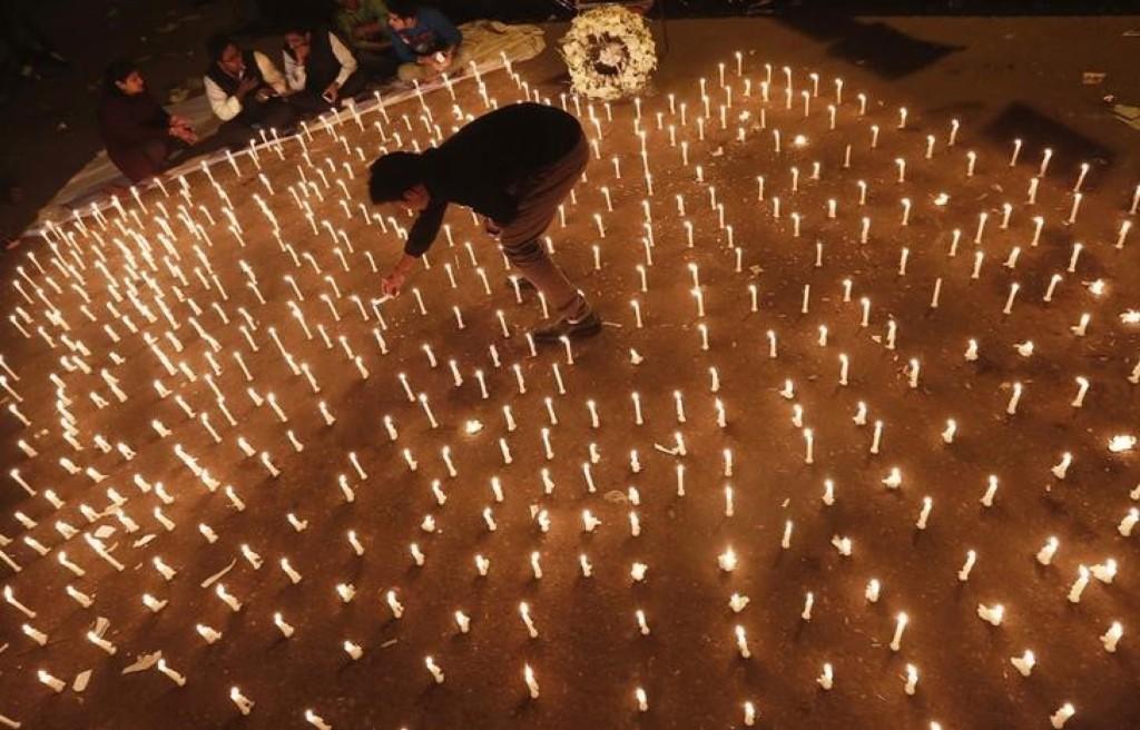 A candlelight vigil marking the first anniversary of the Delhi gang rape. REUTERS/Adnan Abidi