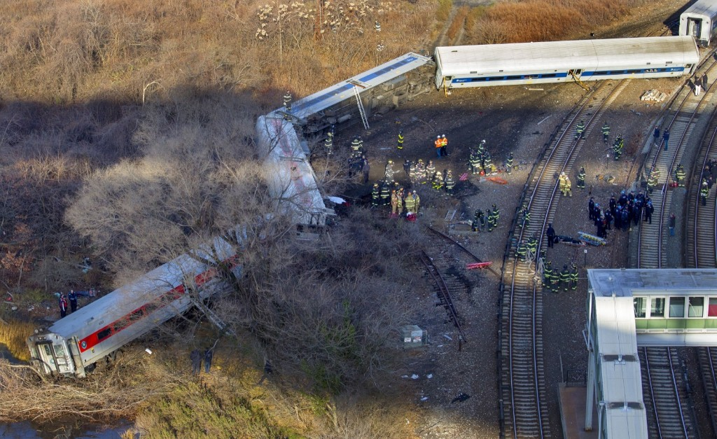 First responders gather at the derailment of a Metro North passenger train in the Bronx, Sunday. Four people were killed and dozens injured in the crash. AP Photo/Craig Ruttle