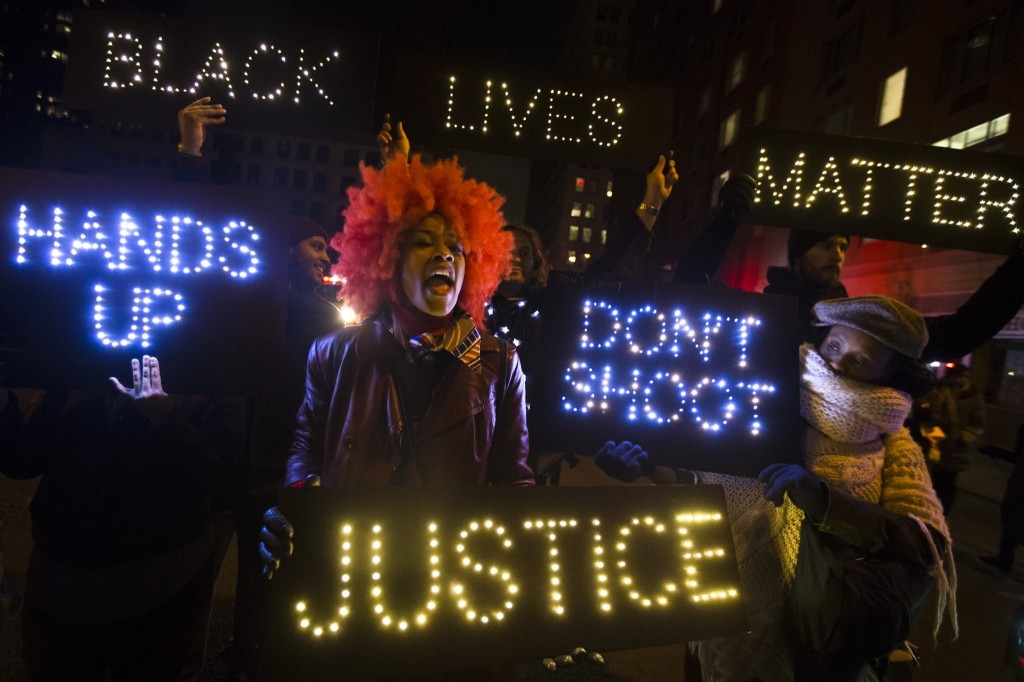 A demonstrator chants during a rally in Manhattan demanding justice after a grand jury decided not to indict officers in the chokehold death of Eric Garner AP Photo/John Minchillo