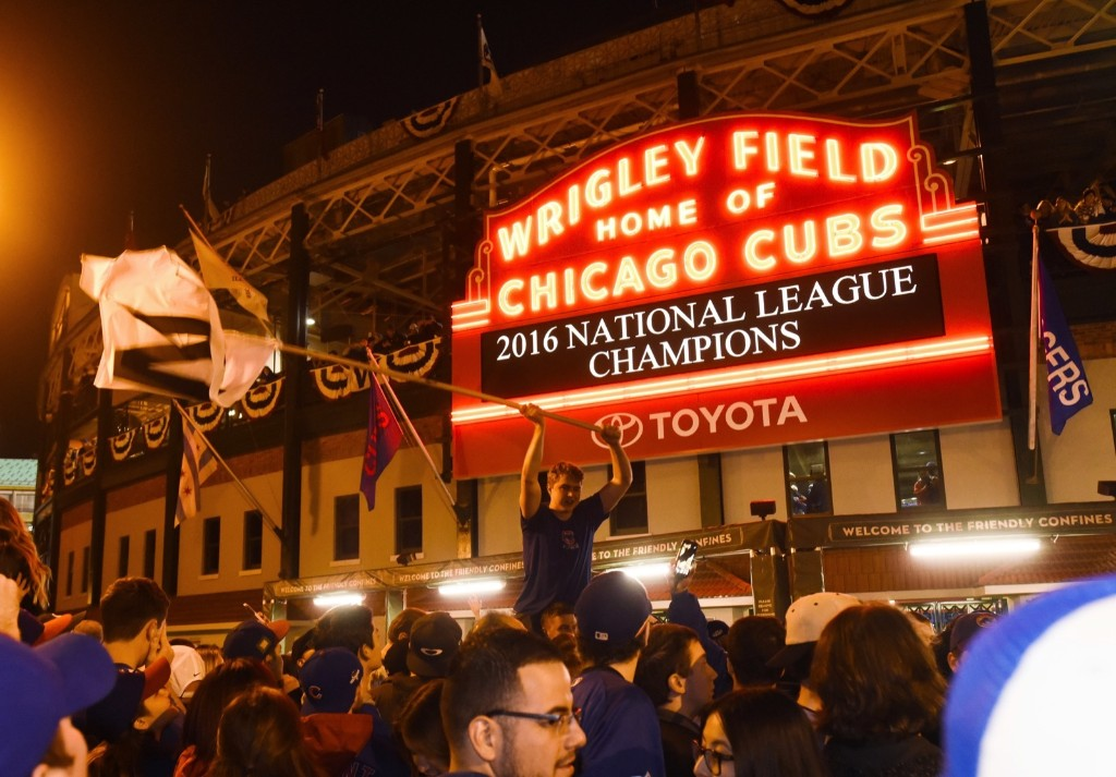 Cub fans celebrate outside Wrigley Field after Game 6 victory over the Dodgers. AP Photo/Matt Marton