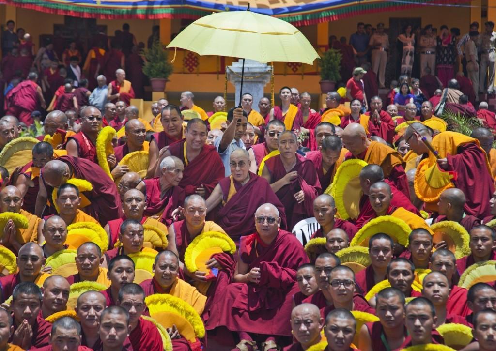 The Dalai Lama sits for a group photo with monks at the Gyuto Monastery in Dharmsala, India. AP Photo/Ashwini Bhatia
