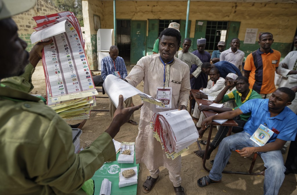 Electoral officials count ballots in front of party agents and observers at a polling station in Kano, northern Nigeria Saturday, Feb. 23, 2019. Nigerians went to the polls for a presidential election Saturday, one week after a surprise delay for Africa's largest democracy. (AP Photo/Ben Curtis)