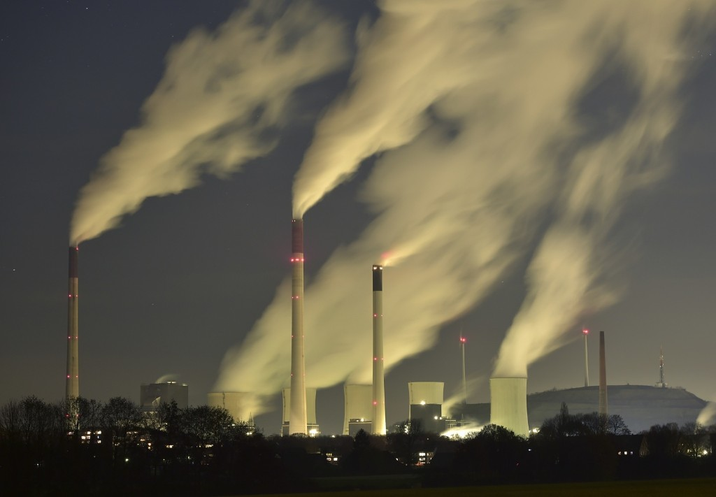 Smoke streams from the chimneys of the E.ON coal-fired power station in Gelsenkirchen, Germany. AP Photo/Martin Meissner