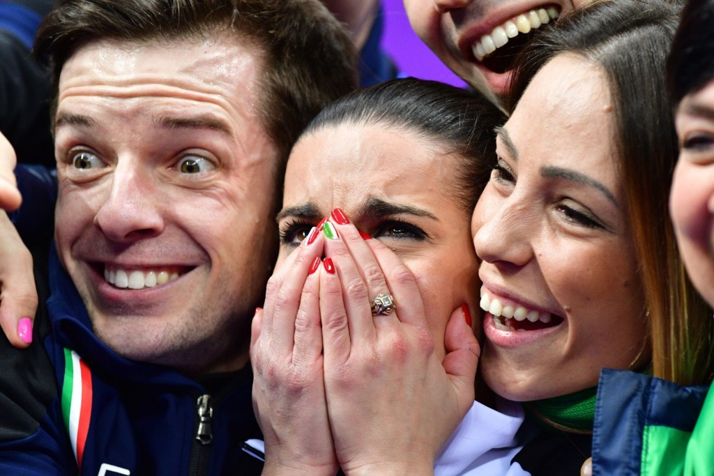 Italy's Valentina Marchei (C) and Ondrej Hotarek (L) after competing in the figure skating team event pairs free skate. MLADEN ANTONOV/AFP/Getty Images