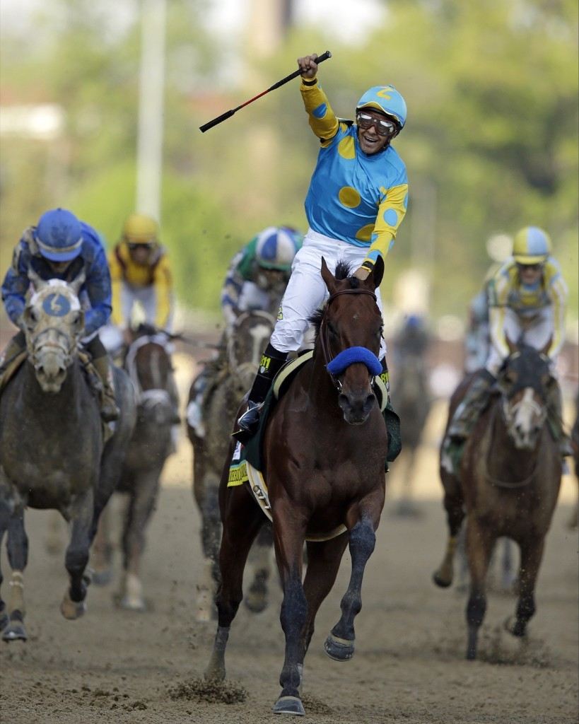 Victor Espinoza rides American Pharoah to victory in the141st running of the Kentucky Derby horse race, at Churchill Downs, Saturday, in Louisville. AP Photo/Darron Cummings