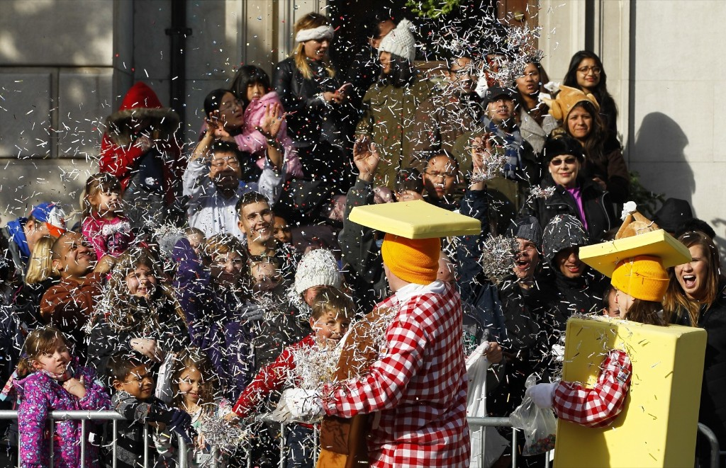 Spectators and clowns throw confetti at each other on Central Park West during the Macy's Thanksgiving Day Parade in New York, Thursday. Photo by Gary Hershorn