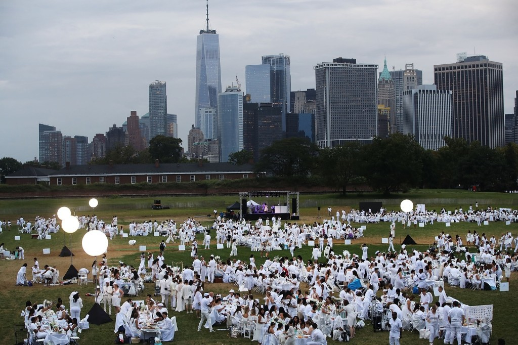 The annual Dinner in White on Governors Island in New York City. Attendees must wear white clothing and bring their own picnic food and white table cloths. Spencer Platt/Getty Images
