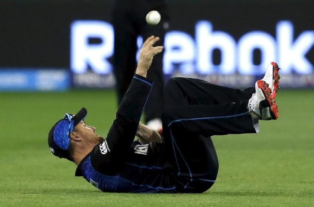 New Zealand's captain Brendon McCullum falls over as he fields a ball hit by Australia's captain Michael Clarke during their Cricket World Cup final match, in Melbourne, Sunday. REUTERS/Jason Reed