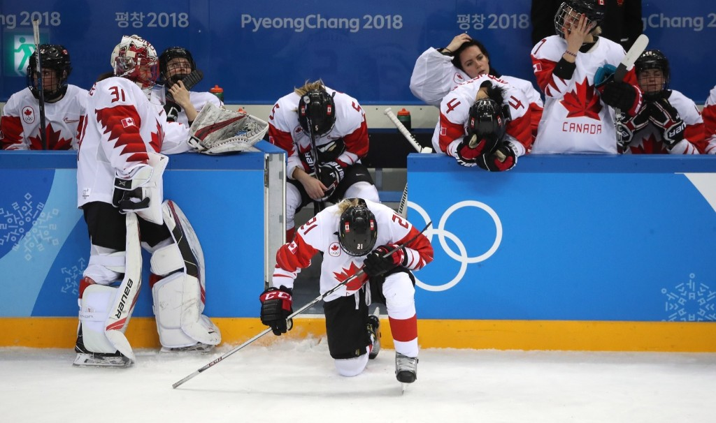 Canada forward Haley Irwin (21) takes a dejected knee after Canada lost in a shootout to the U.S. in hockey gold medal game. Steve Russell/Toronto Star via Getty Images